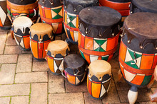 Skin Covered Wooden Drums On D...