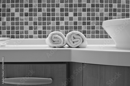 Fotomural  Modern design bathroom with sink, shower, towels and mirror and mosaic tiles in