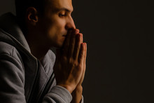 Religious Young Man Praying To...