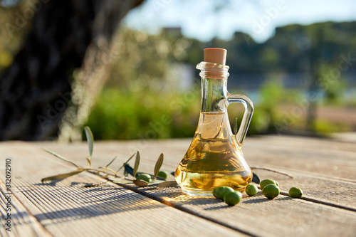 Fotografie, Tablou olive oil with fresh olives and leaves