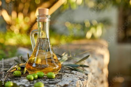 Fototapeta olive oil with fresh olives and leaves obraz