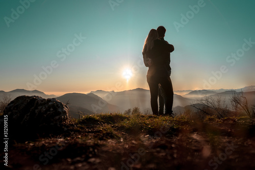 Photo  Love couple hikers couple goals hiking mountain travel traveling