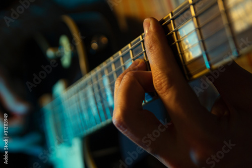 Man's hands play the guitar - 312113949