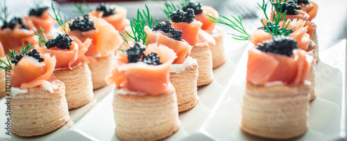 salmon canape with black caviar on plate Wallpaper Mural