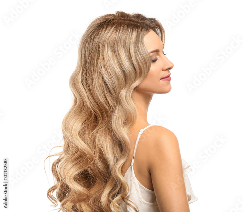 Stampa su Tela Beautiful young woman with curly hair on white background