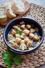 CHAMPINONES AL AJILLO, SPANISH GARLIC MUSHROOMS Roasted In The Oven With Fresh Herbs.