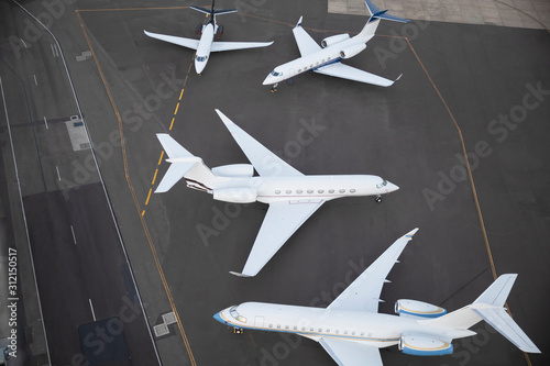 Private jet planes waiting on runway