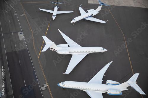 Stampa su Tela Private jet planes waiting on runway