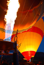 Red Glow Of Blasts From Propane Heaters Inflating Hot Air Balloons At Dawn Cappadocia Turkey