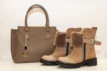 Women's Beige Fur Suede Boots With A Women Bag On A White Background