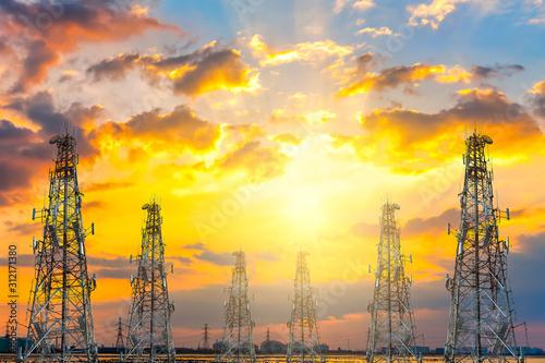 Obraz telecommunication tower at sunset sky background - fototapety do salonu