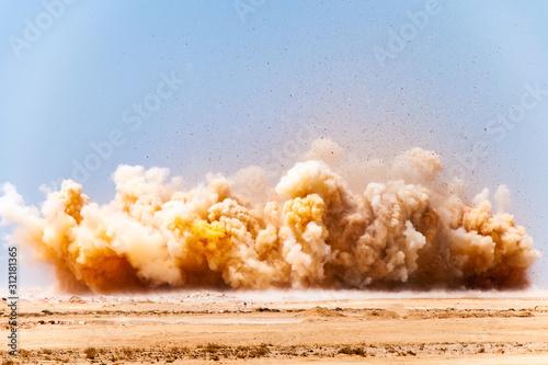 Fotografia  Dust storm and debris during detonator blasting on the construction site