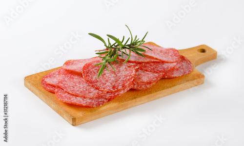 Fototapeta Thinly sliced salami sausage obraz