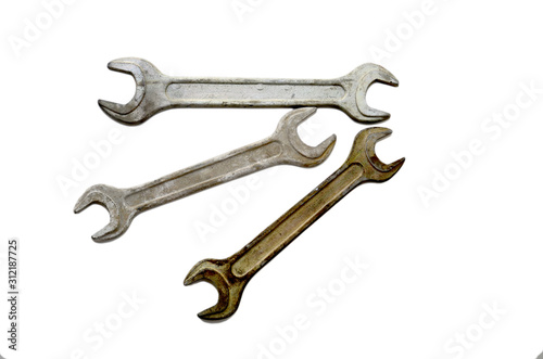 Three isolated keys. Old metal wrenches on a white background. Wallpaper Mural