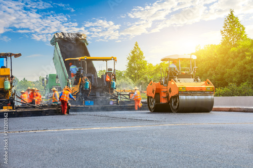 Fototapety, obrazy: Construction site is laying new asphalt road pavement,road construction workers and road construction machinery scene.
