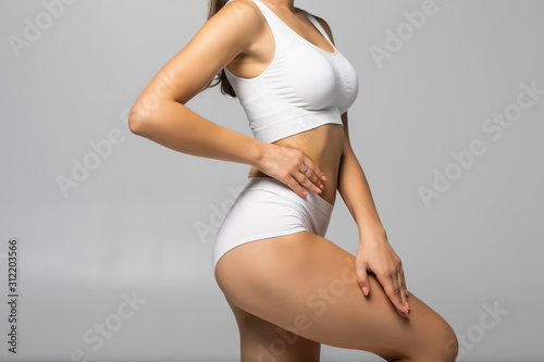 Valokuva Close up shot of unrecognizable fit woman in lingerie isolated on white background
