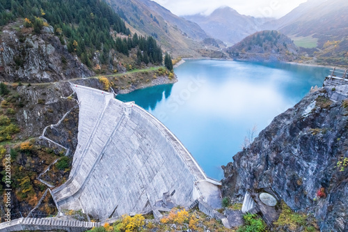 Reservoir lake and water dam in French Alps to produce hydroelectricity, sustainable development using renewable energy and hydropower