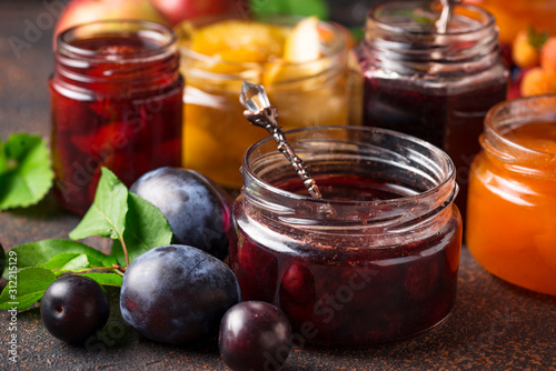 Photographie Assortment of different jams in jars