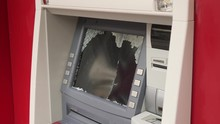 Cash Machine With Smashed Glass.