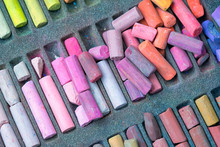 Chalk Sticks Various Colors In A Box Close Up, Colorful Chalk Pastel For Preschool Children, Kid Stationary For Art Painting Education.