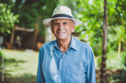 Portrait of smiling beautiful older male farmer Canvas