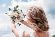 Wedding Bouquet In Hands Of Th...