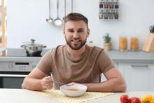 Young Man Eating Tasty Vegetab...