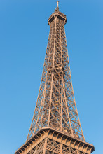 The Eiffel Tower Against The Blue Sky. Close Up. Vertical Picture
