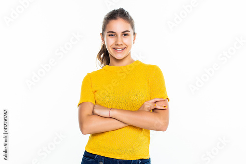 Fotografía Beautiful teen girl student with confident expression, keeps arms folded