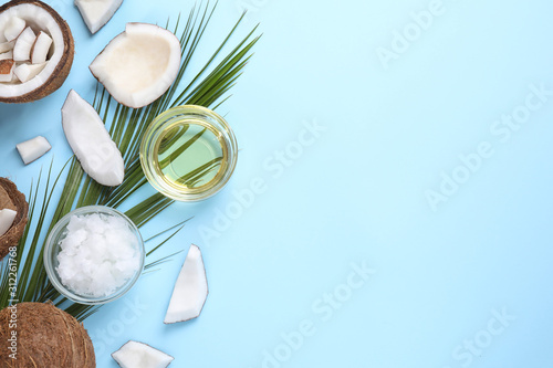 Tablou Canvas Flat lay composition with coconut oil on light blue background, space for text