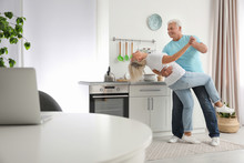 Happy Mature Couple Dancing To...