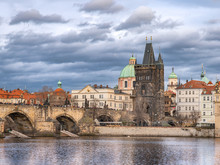 Charles Bridge In Autumn Before Rain, Gray-Blue Cloudy Afternoon Weather, Prague - The Capital Of The Czech Republic