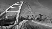 Suspension Bridge And Downtown...