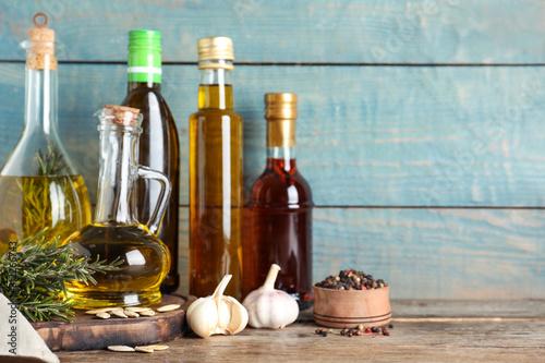 Fototapeta Different cooking oils in bottles on wooden table obraz