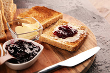 Toast Bread With Homemade Strawberry Jam And Apricot Marmalade On Rustic Table Served With Butter For Breakfast Or Brunch On Table