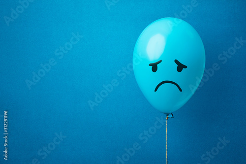 Stock photo of a blue monday balloon on a blue background Fototapeta