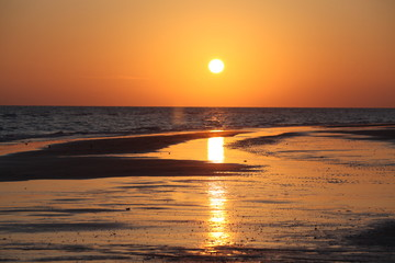 orange sky at sunset with reflection on beach shore #2
