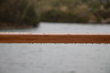 Rain Drops On Wooden Bar