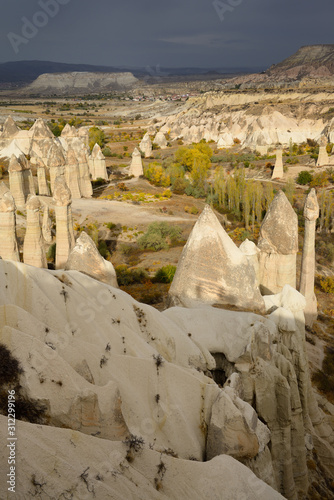 Sun breaking through on phallic Fairy Chimneys in Love Valley Goreme National Pa Tablou Canvas