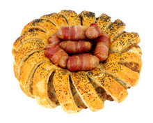 Puff Pastry Garland Ring Filled With Seasoned Pork Sausage Meat With Pigs In Blankets In The Center Isolated On A White Background