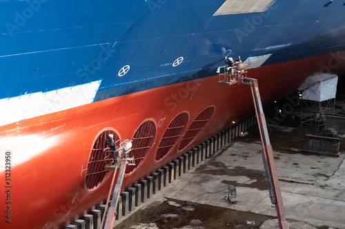 Obraz na płótnie Ship in dry dock in a port for repairs