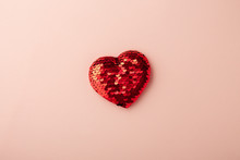 Red Glitter Heart On Pink Background