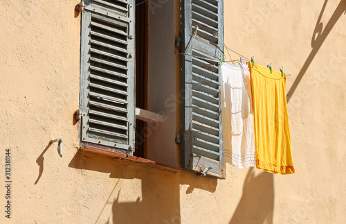 mediterranean style window with drying clothes
