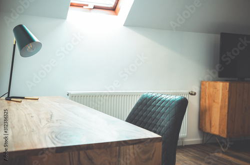 Fototapeta Detail of Room with Wooden Writing Desk and Table Lamp Minimalist Style obraz