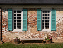 Simple Blue Shutters Around Wh...