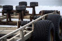 Close Up Of A Boat Trailer With Large Chunky Tyres [tires]