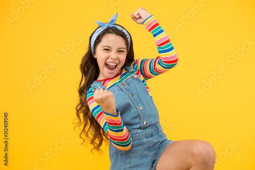 summer vacation joy. little child yellow background. old fashioned handkerchief for kid. beauty and fashion. small girl long hair. happy childhood. retro girl express happiness. feeling great success