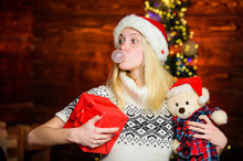 Xmas Mood. Christmas Preparation. All She Wants For Christmas. Cheerful Woman. Woman Got Teddy Bear Toy Present. Santa Hat Christmas Accessory. Cute Gift. Winter Holidays Celebration. Happy New Year