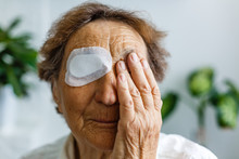 Close Up Picture Of An Elderly Woman's Injured Eye