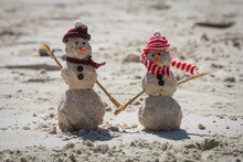 Two Snowmen Made Out Of Sand O...